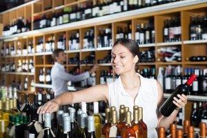 Choosing wine in a shop